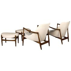 Pair of Ib Kofod-Larsen Elizabeth Chairs and Ottomans, by Christensen or Larsen | From a unique collection of antique and modern chairs at https://www.1stdibs.com/furniture/seating/chairs/