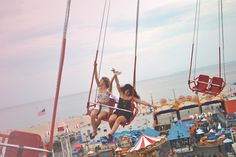 This photo is brightly lit and is colorful, though the colors have been changed to pastel to produce a softer image. The models in the photo are young and having fun on the ride, which gives this photo an uplifting mood, like the previous black&white photo. there facial expressions also show that they are having fun.