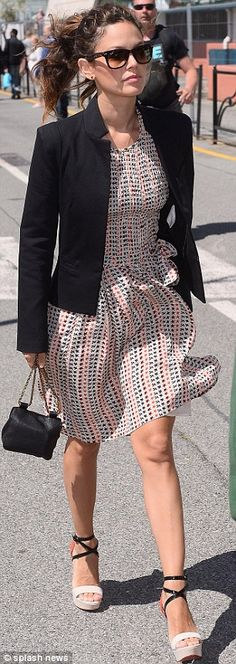 Stride right: The fashion lover showed her personal style in a star-print dress and sky-high strappy sandals