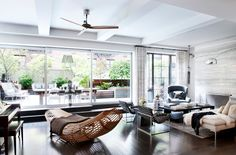 One of the better minimalist ceiling fans I've seen.  Gramercy Loft by David Howell Design