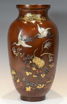HIGH QUALITY JAPANESE BRONZE AND MIXED METAL VASE BY IKEDA YOSHIHISA. The date of manufacture has been declared as 1890.