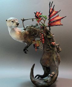 Ellen Jewett    In her sculptures, Ellen Jewett from Guelph, Ontario, makes fantasy sculptures of animals in magical situations. She completed her post secondary education with a degree in Biological Anthropology and Art Critique from McMaster University.