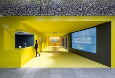 """Initiative Media – New York City Offices. Staff could choose to work at a desk within their """"neighborhood"""", or take their laptop and move to a huddle room, open team area, private phone booth, or communal quiet room."""