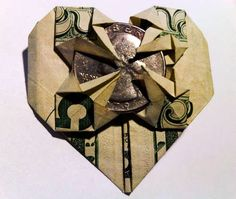 Bill Origami Heart A lovely little origami heart made from a dollar bill. Cute idea for a giving some one money as a gift.A lovely little origami heart made from a dollar bill. Cute idea for a giving some one money as a gift. Origami Star Paper, Origami Swan, Origami Ball, Origami Fish, Money Origami, Heart Origami, Origami Boxes, Origami Flowers, Origami Folding