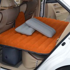This inflatable air bed ($80) that fits into the backseat of your car.