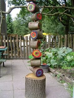 Logs with paint mounted to create a sculpture.