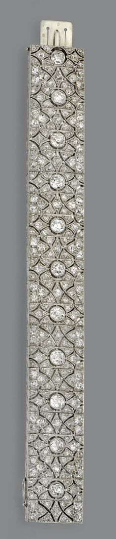 DIAMOND BRACELET, FRENCH, CIRCA 1920 The articulated openwork band pierced in a lace design, set throughout with 242 old European-cut and old-mine diamonds weighing approximately 18.00 carats, mounted in platinum, length 6¾ inches, French assay marks.
