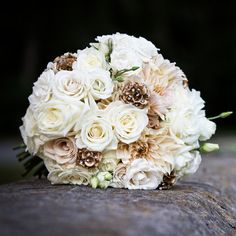 Gold-painted pinecones adorned with crystals put a wintry twist on this soft white bouquet.
