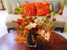 Here's an easy fall project: Floral foam, fall picks from local craft store, brown moss- used my own container. $15 max to put this together, my friend said it looked like a $50 arrangement- Like a Boss!