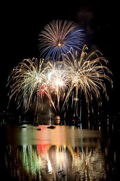 Olympic Photo Group / For the Kitsap Sun The Poulsbo 3rd of July fireworks explode Wednesday night over the waters of Liberty Bay. The show was orchestrated by pyrotechnician Robert Nitz, who also does the Bainbridge show.