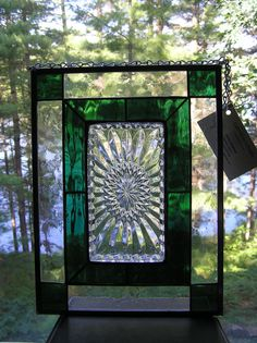 Beautiful stained glass panel, with clear vintage patterned plate surrounded by emerald green coloured water glass. Framed in clear textured