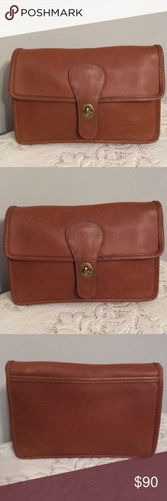 VINTAGE HTF COACH CLUTCH! As a Coach collector I purchased to add to my collection but I'm thinning out to buy more! This clutch is HTF I've only seen 1 other like this. I have never used it and it should be seen and not in my closet. It's in pristine condition! I welcome any questions! I ship the same or next business day! Coach Bags Clutches & Wristlets