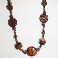 Kazuri Bead Necklace.  Brown Red Green. Fall Colors. Red Creek Jasper and Kazuri Bead. Ethnic Jewelry. African Beads. by riversedgecreations. Explore more products on http://riversedgecreations.etsy.com