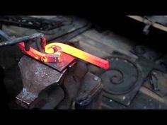 How to forge a wrought iron double spiral - YouTube