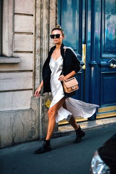 Silky slip dresses can often read as romantic, but if you want to give one a little bit of a sporty edge, then this is how to pull it off. Put your hair in a sleek top knot, then throw on super cat-eye sunglasses, an athletic striped-sleeve jacket over your slip dress, and finish off the outfit with black ankle boots for a final edgy touch. Ta-da!
