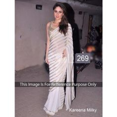 Kareena Kapoor wore a white coloured saree which had golden sequin work on the pallu. To flaunt the sequinned details on the pallu, Kareena opted for the floating style,with a golden sleeveless blouse that had heavy mirror work all over it.-3500/Rs