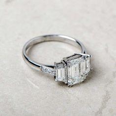 A stunning Emerald Cut Diamond Engagement Ring. Set in a beautiful Platinum Mounting.