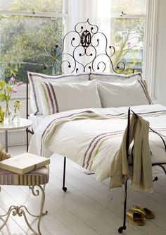 LOVE this headboard and the white floors!