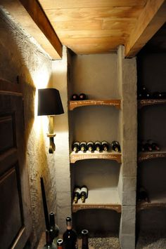 Rustic cave-like walls, wall sconces, paneled or tin ceiling
