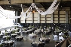 Airplane hanger wedding reception venue | Yuliya M Photography