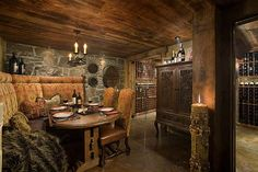 Wine room with rustic wood ceiling.  designed by Locati Interiors. Montana Built-in banquette.
