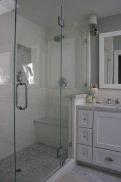 the main bath floor is Carrara marble tiles cut 6x12 and in the shower it's a Carrara marble hexagon mosaic
