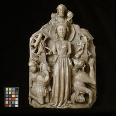 A fifteenth-century English panel portraying the miraculous release of St Catherine of Alexandria from death by torture on spiked wheels; she is shown with a halo and martyr's crown and the broken wheel, her primary symbolic attribute; God, holding an orb, symbol of his global authority, is shown above her. (Victoria & Albert Museum)