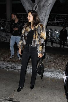 At ease: Mother-of-two Alessandra, who is married to businessman Jamie Mazur, carried a small black purse and wore a thin brown choker, which drew attention to her gorgeous neckline