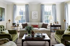 """The palette of the home stemmedfrom the silvery blue Italian wool curtain fabric Suzanne and Laurenchose for the living room. """"It's soft yet sophisticated,"""" says Lauren."""
