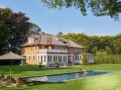 An 1890s Shingle Style home in East Hampton, NY - home of media power duo Pilar Guzmán and Chris Mitchell. (She's the editor of Condé Nast Traveler and he's the publisher of Vanity Fair)