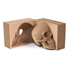 'Vince Cardboard Human Skull' is a build-your-own skull sculpture from Cardboard Safari. Made of recycled, laser-cut cardboard, the product is shipped flat, and arrives with detailed instructions, ready for assembly at home. Three sizes are available: Large, Micro and Boxed Edition, with difficulty level proportional to product size. White, black, brown and zebra are the color options. Vince Cardboard Human Skull's retail price ranges from $40 to $200.