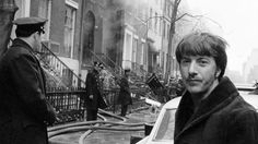 Dustin Hoffman stands outside his home on West 11th street. The house next door was destroyed by the Weather Underground who accidentally detonated a bomb they were assembling in the basement 3 Weathermen were killed the blast blew a hole in Hoffmans living room wall. March 6 1970. [736 x 414]