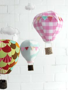 I think I found the mobile I'll be making for Joy! Hot air balloon & clouds mobile sewing pattern