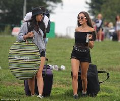 All smiles: Two girls smile happily as they arrive to see performers such as Calvin Harris...