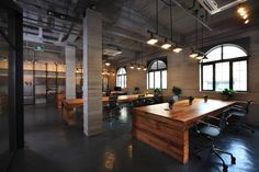 i drool on these shared tables. Quality materials with flexible seating arrangements. [Flamingo Office - Asylum]