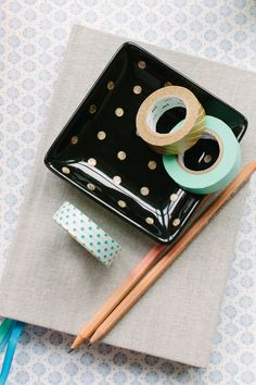 This is a DIY trick from Fellow Fellow. Gold Nail polish polka dots on a dish or jar using those stickers that reinforce paper holes as a template. Paint, peel, and voila! Really easy and so so sweet.
