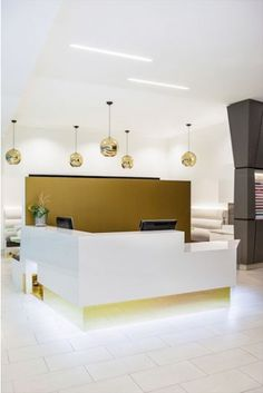 LIGHTING   gold accent reception area beauty salon interior design barefootstyling.com