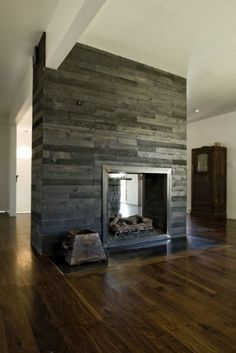 Love all the wood and the fireplace that goes through.
