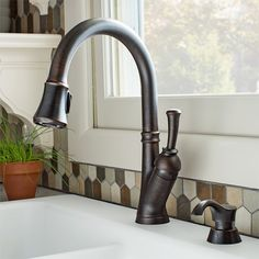 This Venetian bronze-finish faucet sports a pull-down spout and a high-end appearance.