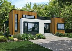 Great modern facade to Architectural Designs House Plan 80824PM, 2 beds, 1 bath and around 1,300 sq. ft. of living. Ready when you are. Where do YOU want to build?