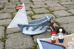 Handquilted Pirate Play Mat from Songbird & Hollow at Etsy comes with two cute peg doll pirates + cloth boat
