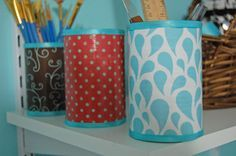 storage containers made from tin soup cans and mod podge----see!!! U guys laughed at me for saving my soup cans!!!   Look how pretty!!!  A house full of girls NEEDS storage!!!  One and a half baths to 4 girls and dad is NOT easy lol