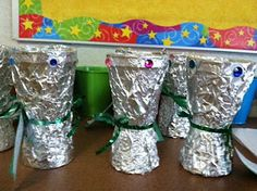 Cover a plastic cup (or two glue bottom to bottom) in foil, then decorate with sequins and ribbon/yarn to make a festive unity cup for Kwanzaa.