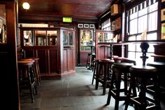 Toners Pub Dublin, beautiful original flagstone floor, dark timbers, gorgeous pub mirrors...just lovely!!