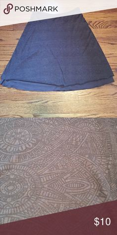 "Cotton skirt Grey with a black detailed pattern throughout skirt ( pic 2). Has about 1-2"" at the bottom that is solid grey ...it's actually a layered skirt.  Solid grey underneath with the patterned "" skirt"" over it ( pic 3). Approximately 20"" long Tehama Skirts Mini"
