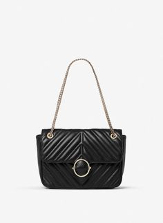 Uterqüe United Kingdom Product Page - Clothing - View all - Quilted leather crossbody bag - 175