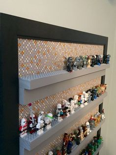 Lego character board - black frame with fabric backing. Shelves made of wood and painted, then screwed into ply wood back board. Lego strips cut and glued to shelves.