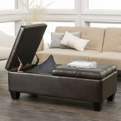 The Braswell double opening leather storage ottoman is fully covered in beautifully soft leather. Gently tufted and with matching espresso legs, you will proudly display your ottoman in a prominent high-traffic area.