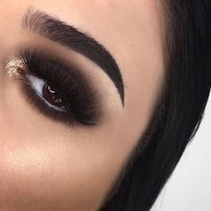 "Dark smokey eye with a pop of glitter! Recreate this look with NYX Cosmetics 'Hot Singles Eye Shadow' in ""Raven"" and 'Face & Body Glitter' in ""Gold""."