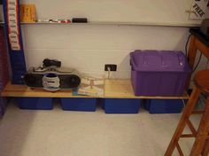 I love this cheap classroom storage idea! This teacher placed two solid boards from the lumber supply store  on top  of her bins and now there is a mini shelf for more things!